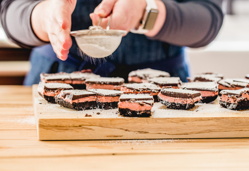 Sprinkling Powdered Sugar over Mexican Hot Chocolate Shortbread Bars