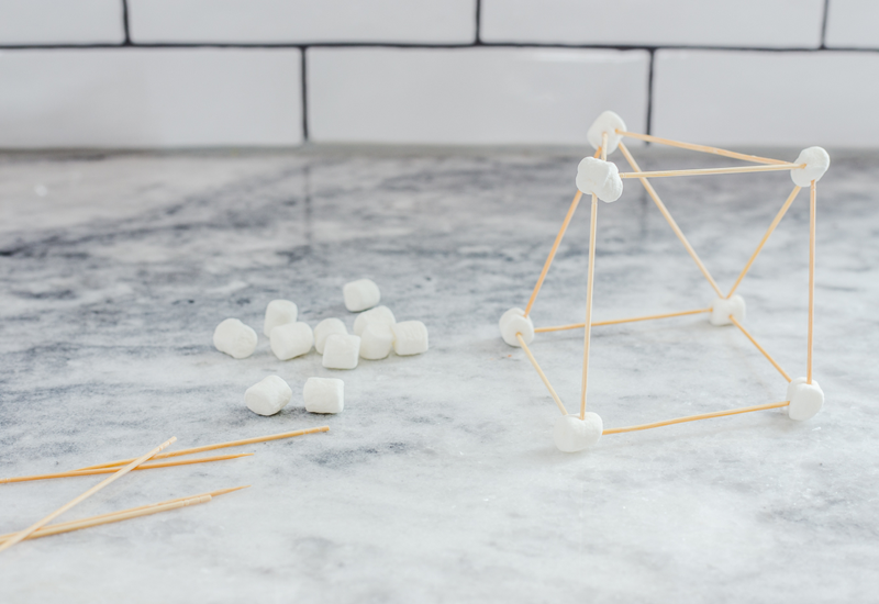 Toothpicks and marshmallows on counter