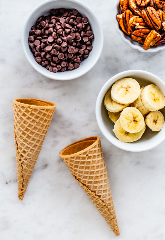 ice cream cones with chocolate chips, banana slices, and pecans