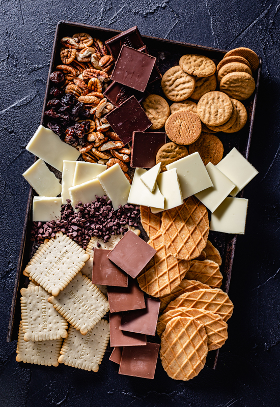 chocolate, cheese, and crackers on tray