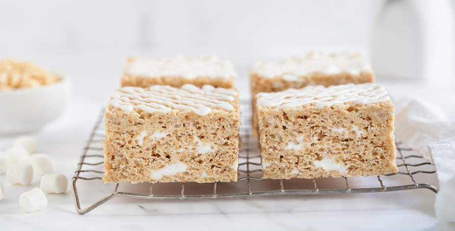 Brown Butter Rice Krispie Treats on cooling rack with coffee