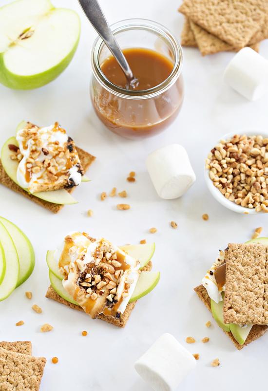 Making Caramel Apple S'mores on white table
