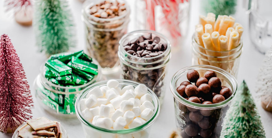 Holiday Hot Chocolate Bar bottle brush Christmas trees and jars of hot chocolate toppings