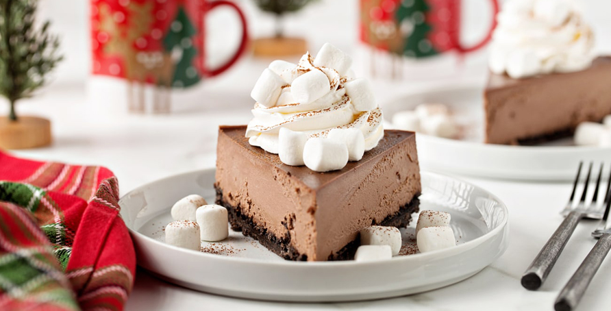 Hot Cocoa Cheesecake with whipped cream and mini marshmallows