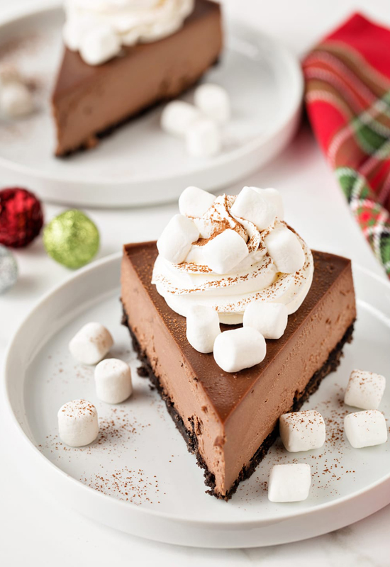 mini marshmallows and whipped cream on Hot Cocoa Cheesecake