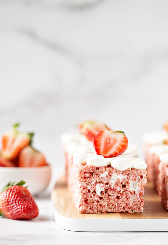 Strawberry Rice Krispie Treats with bowl of strawberries
