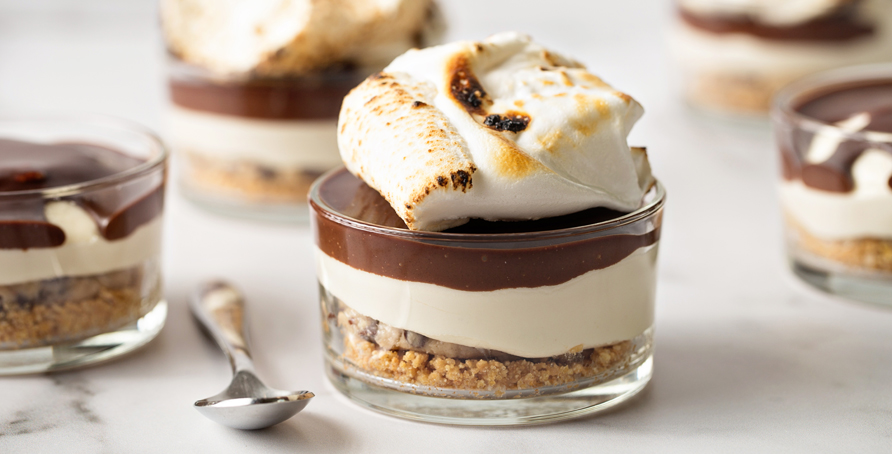 individual Cookie Dough S'mores Cheesecakes in glass dishes